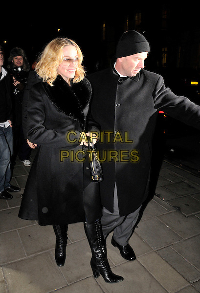 MADONNA.Leaving Capriani Restaurant, London, England..December 13th, 2007.full length black coat fur trim lined boots sunglasses shades bag purse .CAP/IL.©Ian Leonard/Capital Pictures.