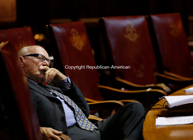 Hartford, CT- 03 June 2015-060315CM11-  State Senator Joseph Crisco Jr., (D- 17) takes a moment during a budget proposal inside the Senate Chamber at the State Capitol in Hartford on Wednesday.  Christopher Massa Republican-American