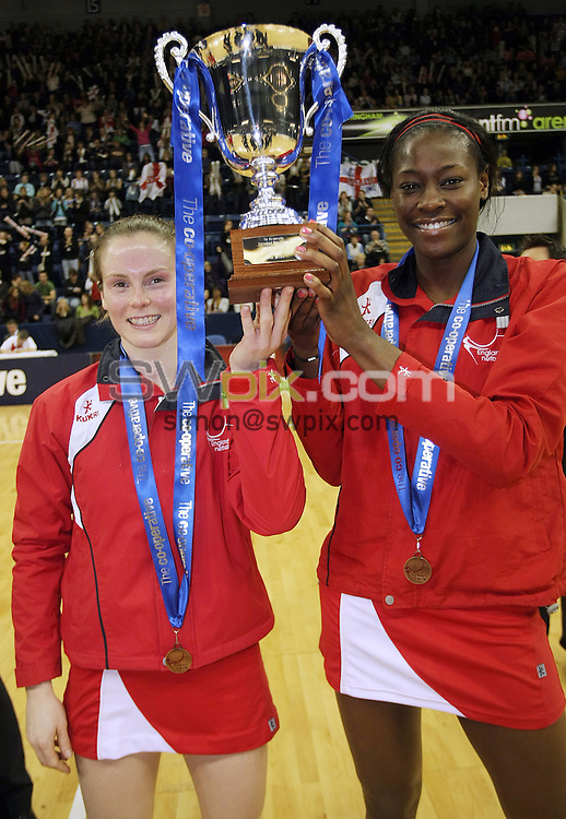 PICTURE BY VAUGHN RIDLEY/SWPIX.COM - Netball - The Co-Operative International Series - England v Jamaica, Third Test - Trent FM Arena, Nottingham, England - 26/02/09...Copyright - Simon Wilkinson - 07811267706...England's Karen Atkinson and Sonia Mkoloma with the winner's trophy.