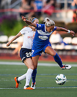 Sky Blue FC midfielder Manya Makoski (22) tackles Boston Breakers forward Kyah Simon (17).  In a National Women's Soccer League Elite (NWSL) match, Sky Blue FC defeated the Boston Breakers, 3-2, at Dilboy Stadium on June 16, 2013
