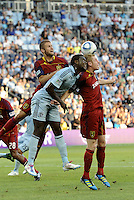 L-R Chris Wingert Real Salt Lake, Kei Kamara Sporting Kc, Nat Borchers Real Salt Lake attacking the ball from a corner kick... Sporting Kansas City defeated Real Salt Lake 2-0 at LIVESTRONG Sporting Park, Kansas City, Kansas.