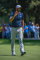Dustin Johnson (USA) after sinking his par putt on 9 during round 4 of the World Golf Championships, Mexico, Club De Golf Chapultepec, Mexico City, Mexico. 3/4/2018.<br /> Picture: Golffile | Ken Murray<br /> <br /> <br /> All photo usage must carry mandatory copyright credit (&copy; Golffile | Ken Murray)