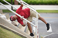 Melody Roman, with Athletic Facilities at the University of Arkansas, rolls on a layer of paint Friday, June 26, 2020, on the stairway railing in the west parking lot of Donald W. Reynolds Razorback Stadium on the campus of the University of Arkansas in Fayetteville. Crews have been repainting the railing and the foot bridge that passes over Razorback Road and connects the lot to the stadium. Check out nwaonline.com/200627Daily/ and nwadg.com/photos for a photo gallery.<br /> (NWA Democrat-Gazette/David Gottschalk)