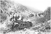K-27 #452 derailed and on its side in an arroyo,  Men and women around engine.  The clothing suggests late 1890s to early 1900s.  Note the positioning of the smokebox number plate for the photo.<br /> D&amp;RG    10/1903