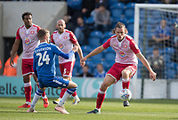 Ben Nugent of Stevenage clears from defence under pressure from Ben Stevenson of Colchester United during Colchester United vs Stevenage, Sky Bet EFL League 2 Football at the JobServe Community Stadium on 5th October 2019