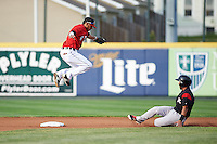 Erie SeaWolves shortstop Harold Castro (1) jumps for a throw as  Ali Castillo (7) slides into second base during a game against the Richmond Flying Squirrels on May 27, 2016 at Jerry Uht Park in Erie, Pennsylvania.  Richmond defeated Erie 7-6.  (Mike Janes/Four Seam Images)