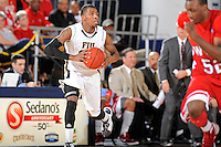 28 January 2012:  FIU guard Jeremy Allen (32) prepares to pass the ball in the second half as the Western Kentucky University Hilltoppers defeated the FIU Golden Panthers, 61-51, at the U.S. Century Bank Arena in Miami, Florida.