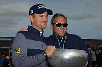 Bernd Wiesberger (AUT) poses with the trophy with his caddie Jamie Lane after the final round of the Made in Denmark presented by Freja, played at Himmerland Golf & Spa Resort, Aalborg, Denmark. 26/05/2019<br /> Picture: Golffile | Phil Inglis<br /> <br /> <br /> All photo usage must carry mandatory copyright credit (© Golffile | Phil Inglis)