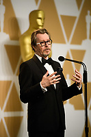 Gary Oldman poses backstage with the Oscar&reg; for Performance by an actor in a Leading role, for work on &ldquo;Darkest Hour&rdquo; during the live ABC Telecast of The 90th Oscars&reg; at the Dolby&reg; Theatre in Hollywood, CA on Sunday, March 4, 2018.<br /> *Editorial Use Only*<br /> CAP/PLF/AMPAS<br /> Supplied by Capital Pictures
