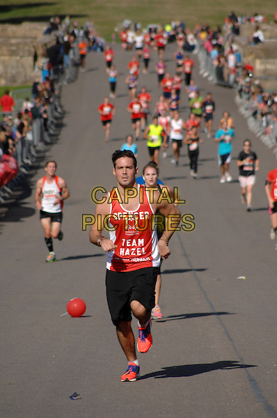 Spencer Matthews<br /> British Heart Foundation 10k run at Blenheim Palace, Woodstock, Oxfordshire, England.<br /> 6th October 2013<br /> full length red top black shorts running jogging exercise <br /> CAP/PP/GM<br /> &copy;Gary Mitchell/PP/Capital Pictures