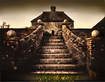 An impressive stone stairway leading to a house