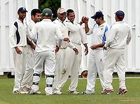 Vimal Arjan (3rd R) is mobbed after taking a Brondesbury wicket during the Middlesex Cricket League Division Two game between Brondesbury and Wembley at Harman Drive, London on Sat Aug 1, 2015