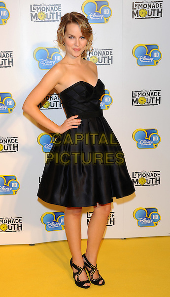 "Bridgit Mendler.""Lemonade Mouth"" special TV screening, BAFTA, Piccadilly, London, England..August 25th, 2011.full length black strapless dress hands on hips.CAP/CJ.©Chris Joseph/Capital Pictures."