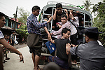 Aung Mingalar district , the center of Sittwe . The Muslim population , to move has to be recorded , counted and loaded on a truck by police with the assistance of a local collaborator.<br />