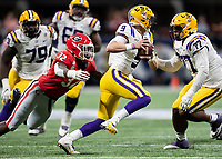 ATLANTA, GA - DECEMBER 7: Joe Burrow #9 of the LSU Tigers evades a pass rush by Monty Rice #32 of the Georgia Bulldogs during a game between Georgia Bulldogs and LSU Tigers at Mercedes Benz Stadium on December 7, 2019 in Atlanta, Georgia.