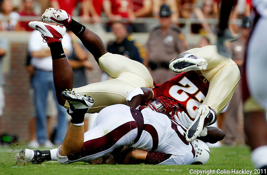 TALLAHASSEE, FL 9/3/11-FSU-ULM FB090311 CH-Florida State's Nick Moody, left, and Telvin Smith combine on the tackle of University of Louisiana at Monroe's Kolton Browning during first half action Saturday at Doak Campbell Stadium in Tallahassee. .COLIN HACKLEY PHOTO