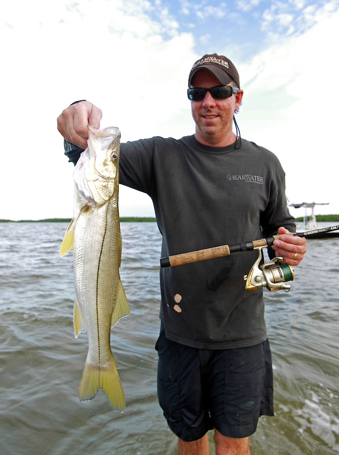 Captain Tom Shurtleff with a small snook in the Florida Everglades and the 10,000 islands out of Chokoloskee Island. Photo/Andrew Shurtleff