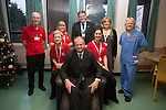 Keith Farron from TATA Steel with volunteers from Age Cymru at St Woolos Hospital in Newport.<br /> <br /> 05.12.13<br /> &copy;Steve Pope-FOTOWALES