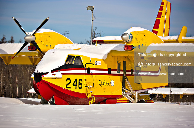 Quebec City, January 24, 2008 - A Bombardier 415 (formerly Canadair CL-415) of the A Société de protection des forêts contre le feu (SOPFEU) lies in the snow at the Quebec City airport. The 415 is a Canadian amphibious aircraft purpose-built as a water bomber. It is the only aircraft designed and built specifically for aerial firefighting and is based on the company's CL-215. It is marketed in the USA as the Superscooper.