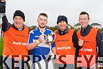 The Kerry management team l-r: Padraig O'Sullivan, Mickey Ned O'Sullivan and Shane O Duinneacha behind Colaiste Ghobnatan Ballyvourney celebrate with their captain Micheal O Duinnin after their Corn Sheain Ui Mhurchu final victory over PS Inbhear Sceine in Killarney on Saturday