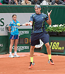 Robby Ginepri (USA) falls behind Rafael Nadal (ESP) 6-0, 4-3 at  Roland Garros being played at Stade Roland Garros in Paris, France on May 26, 2014