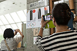 People take pictures of the Tokyo 2020 Olympics and Tokyo 2020 Paralympic Games logos at the Tokyo Metropolitan building on September 1, 2015, Tokyo, Japan. The Tokyo Olympic organizers have decided to drop the logo for the 2020 Games after an emergency meeting on Tuesday September 1st. Designer Kenjiro Sano's logo had been critized after Belgian, Olivier Debie, instigated legal action due to similarities to his logo for the Theater de Liege in Belgium. Beleaguered Sano has also recently faced other questions of plagiarism over his past designs. (Photo by Rodrigo Reyes Marin/AFLO)