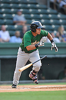 Designated hitter Natanael Ramos (15) of the Savannah Sand Gnats bats in a game against the Greenville Drive on Thursday, September 3, 2015, at Fluor Field at the West End in Greenville, South Carolina. (Tom Priddy/Four Seam Images)
