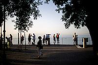 Tourists enjoy a view of the Gulf of Naples on Thursday, Sept. 17, 2015, in Sorrento, Italy. (Photo by James Brosher)