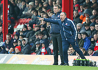 Bolton Wanderers manager Phil Parkinson watches on while assistant manager Steve Parkin shouts instructions to his team from the technical area<br /> <br /> Photographer Alex Dodd/CameraSport<br /> <br /> The EFL Sky Bet Championship - Brentford v Bolton Wanderers - Saturday 13th January 2018 - Griffin Park - Brentford<br /> <br /> World Copyright &copy; 2018 CameraSport. All rights reserved. 43 Linden Ave. Countesthorpe. Leicester. England. LE8 5PG - Tel: +44 (0) 116 277 4147 - admin@camerasport.com - www.camerasport.com