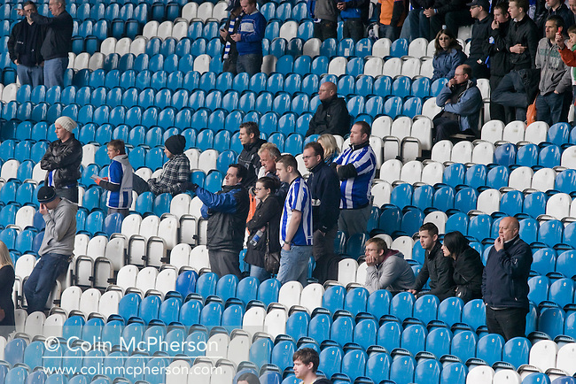 Sheffield Wednesday fans looking forlornly down from the Kop at Hillsborough after the final whistle of the crucial last-day relegation match against Crystal Palace. The match ended in a 2-2 draw which meant Wednesday were relegated to League 1. Crystal Palace remained in the Championship despite having been deducted 10 points for entering administration during the season.