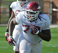 NWA Democrat-Gazette/Michael Woods --03/31/2015--w@NWAMICHAELW... University of Arkansas defensive lineman Bijhon Jackson runs drills during Tuesday afternoons practice in Fayetteville.