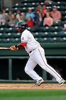 Third baseman Rafael Devers (13) of the Greenville Drive bats in a game against the Asheville Tourists on Friday, April 24, 2015, at Fluor Field at the West End in Greenville, South Carolina. Devers is the No. 6 prospect of the Boston Red Sox, according to Baseball America. Greenville won, 5-2. (Tom Priddy/Four Seam Images)