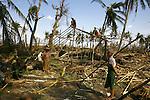 Cyclone Nargis survivors rebuild a home in the village of Kamingo, at the Irrawaddy Division, May 10, 2008. Despairing survivors in Myanmar awaited emergency relief on Friday, a week after 100,000 people were feared killed as the cyclone roared across the farms and villages of the low-lying Irrawaddy delta region. The storm is the most devastating one to hit Asia since 1991, when 143,000 people were killed in neighboring Bangladesh. Photo by Eyal Warshavsky  *** Local Caption *** ëì äæëåéåú ùîåøåú ìàéì åøùáñ÷é àéï ìòùåú áúîåðåú ùéîåù ììà àéùåø
