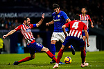 Mikel San Jose Dominguez of Athletic de Bilbao (C) is tackled by Diego Roberto Godin Leal of Atletico de Madrid (L) during the La Liga 2018-19 match between Atletico de Madrid and Athletic de Bilbao at Wanda Metropolitano, on November 10 2018 in Madrid, Spain. Photo by Diego Gouto / Power Sport Images
