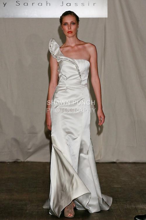 Model walks the runway in a Sahar wedding dress - double face silk satin Swarovski Crystals - by Sarah Jassir for the SARANTINA by Sarah Jassir Spring 2011 runway show, during New York Bridal Week Spring 2011.