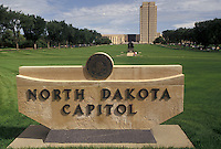 "AJ3534, State Capitol, Bismarck, State House, North Dakota, North Dakota State Capitol sign in the foreground with the State Capitol Building """"skyscraper of the prairie"""" in the distance in the capital city of Bismarck in the state of North Dakota."