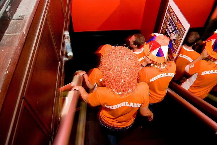 Netherlands fans watch their team's match against the Ivory Coast at Tonic, a New York City nightclub, on June 16, 2006.<br /> <br /> The World Cup, held every four years in different locales, is the world's pre-eminent sports tournament in the world's most popular sport, soccer (or football, as most of the world calls it).  Qualification for the World Cup is open to any country with a national team accredited by FIFA, world soccer's governing body. The first World Cup, organized by FIFA in response to the popularity of the first Olympic Games' soccer tournaments, was held in 1930 in Uruguay and was participated in by 13 nations.    <br /> <br /> As of 2010 there are 208 such teams.  The final field of the World Cup is narrowed down to 32 national teams in the three years preceding the tournament, with each region of the world allotted a specific number of spots.  <br /> <br /> The World Cup is the most widely regularly watched event in the world, with soccer teams being a source of national pride.  In most nations, the whole country is at a standstill when their team is playing in the tournament, everyone's eyes glued to their televisions or their ears to the radio, to see if their team will prevail.  While the United States in general is a conspicuous exception to the grip of World Cup fever there is one city that is a rather large exception to that rule.  In New York City, the most diverse city in a nation of immigrants, the melting pot that is America is on full display as fans of all nations gather in all possible venues to watch their teams and celebrate where they have come from.