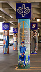 "The ""Undefeated Since 1938"" mural under the Fullerton ""L"" Station in Lincoln Park. Brother Mark Elder, C.M., an adjunct faculty member in DePaul's art, media and design program, has lead the charge to install murals under the Fullerton ""L"" Station in Lincoln Park that highlight DePaul University's history. <br /> <br /> Elder's artistic retrospective, titled ""The Story of 'The Little School Under the 'L'', will eventually feature 25 murals permanently installed on the massive concrete pillars that support the ""L"" station nearest the university's Lincoln Park Campus. (DePaul University/Jamie Moncrief)"