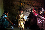 While Sushma is nursing her daughter in Nutritional Rehabilitation Centre in the hospital, her 3 year old son, Chota Raja is seen with his aunt and grandmother in their kitchen in village Karhai outside of Jhansi, Uttar Pradesh, India. The Indian government spends $1.4 billion a year - on programs that include weighing newborn babies, counseling mothers on healthy eating and supplementing meals, but none of this is yeilding results. According to UNICEF, some 48% of Indian children, or 61 million kids, remain malnourished, the clinical condition of being so undernourished that their physical and mental growth are stunted. Photo: Sanjit Das/Panos for The Wall Street Journal.Slug: IMALNUT