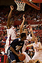 01 December 2010: Jackson State guard Jenirro Bush (5) puts the ball up against Nebraska center Jorge Brian Diaz (21) and guard Caleb Walker (25) at the Devaney Sports Center in Lincoln, Nebraska. Nebraska defeated Jackson State 76 to 57.