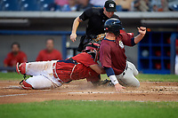 Williamsport Crosscutters catcher Rafael Marchan (13) tags out Michael Tinsley (15) as he slides home in front of home plate umpire Kevin Mandzuk during a game against the Mahoning Valley Scrappers on August 28, 2018 at BB&T Ballpark in Williamsport, Pennsylvania.  Williamsport defeated Mahoning Valley 8-0.  (Mike Janes/Four Seam Images)