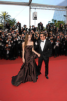 ANGELINA JOLIE &amp; BRAD PITT<br /> 'The Tree of Life' premiere at the Palais des Festival, 64th International Cannes Film Festival, France<br /> 16th May 2011<br /> full length strapless silk satin brown dress gown black tux tuxedo tinted glasses sunglasses shades couple gathered goatee facial hair profile holding hands photographers press<br /> CAP/PL<br /> &copy;Phil Loftus/Capital Pictures /MediaPunch ***NORTH AND SOUTH AMERICAS ONLY***
