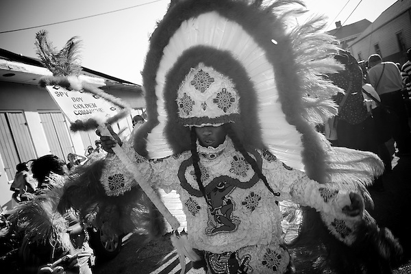 A Mardi Gras Indian from the Golden Comanche Tribe dances outside the Backstreet Museum. The Mardi Gras Indians are a long standing tradition among black residents and it was feared that they would not return after the storm..The Mardi Gras celebrations culminated with parades, dancing and partying all over New Orleans on Fat Tuesday, the traditional end to the long Mardi Gras Week. Thousands were on hand to let this historic day pass into history..