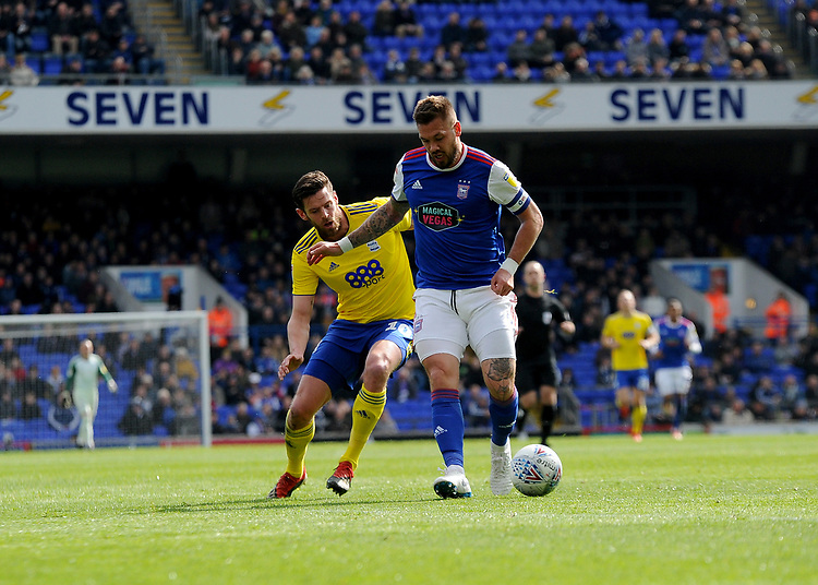 Birmingham City's Lukas Jutkiewicz battles with Ipswich Town's Luke Chambers<br /> <br /> Photographer Hannah Fountain/CameraSport<br /> <br /> The EFL Sky Bet Championship - Ipswich Town v Birmingham City - Saturday 13th April 2019 - Portman Road - Ipswich<br /> <br /> World Copyright © 2019 CameraSport. All rights reserved. 43 Linden Ave. Countesthorpe. Leicester. England. LE8 5PG - Tel: +44 (0) 116 277 4147 - admin@camerasport.com - www.camerasport.com