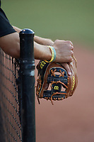 A Concord A's player hangs his Wilson A2000 glove over the dugout railing during the game against the Mooresville Spinners at Moor Park on July 31, 2020 in Mooresville, NC. The Spinners defeated the Athletics 6-3 in a game called after 6 innings due to rain. (Brian Westerholt/Four Seam Images)
