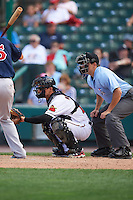 Rochester Red Wings catcher John Ryan Murphy (12) and umpire Jansen Visconti await the pitch during a game against the Pawtucket Red Sox on June 29, 2016 at Frontier Field in Rochester, New York.  Pawtucket defeated Rochester 3-2.  (Mike Janes/Four Seam Images)