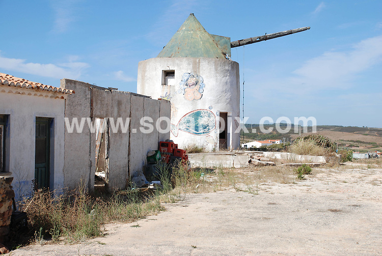 **ALL ROUND PICTURES FROM SOLARPIX.COM**.**WORLDWIDE SYNDICATION RIGHTS**.In the small hill top village of Vila do Bispo in the western Algarve close to Sagres, windmills have been modernised for habitation. ..This pic: windmill awaiting modernisation..JOB REF:     4363    PPL        DATE: 21_07_2007.**MUST CREDIT SOLARPIX.COM OR DOUBLE FEE WILL BE CHARGED* *UNDER NO CIRCUMSTANCES IS THIS IMAGE TO BE REPRODUCED FOR ANY ONLINE EDITION WITHOUT PRIOR PERMISSION*