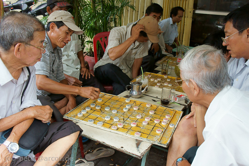 old men playing a acient asian version of chess in the streets of Phnom Penh, Cambodia, August 2011