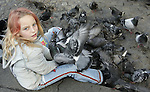 AMSTERDAM - NETHERLANDS - 19 OCTOBER 2004 --  The Dam square in the city centre. Manuela a seven year old girl feeding the pigeons on the square. -- PHOTO:  EUP-IMAGES / JUHA ROININEN