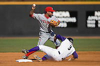 Shortstop Danny Espinosa #3 of the Potomac Nationals turns a double play as Greg Paiml #3 of the Winston-Salem Dash tries to break it up at Wake Forest Baseball Park May 10, 2009 in Winston-Salem, North Carolina. (Photo by Brian Westerholt / Four Seam Images)